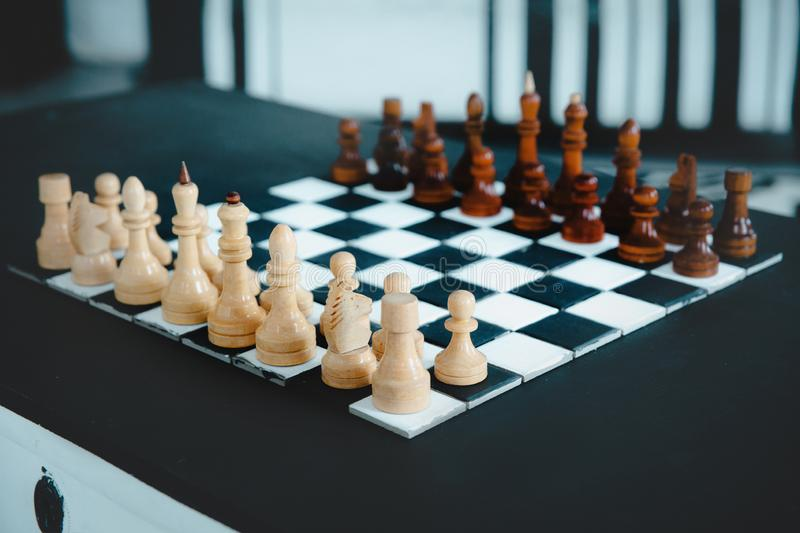Black and white wooden chess set before the game on the chessboard. royalty free stock photos