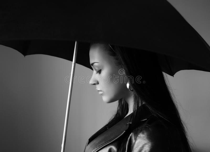 Black and white young woman with umbrella royalty free stock photo