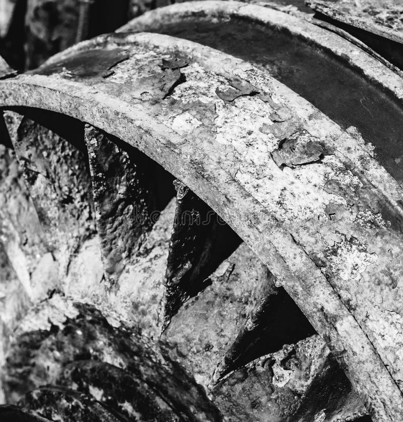 Vintage Black and whites old industry machinery. Gearwheels on a piece of old fashioned machinery stock image