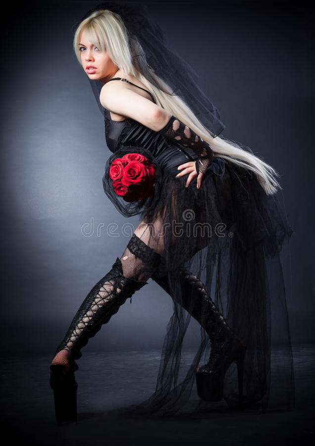 Black Widow In Grief  With Flowers  With A Veil Stock Photos