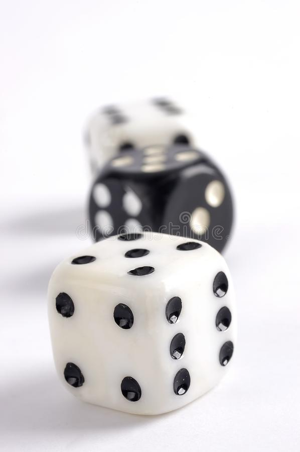 Black and wihite dice on a white background royalty free stock image