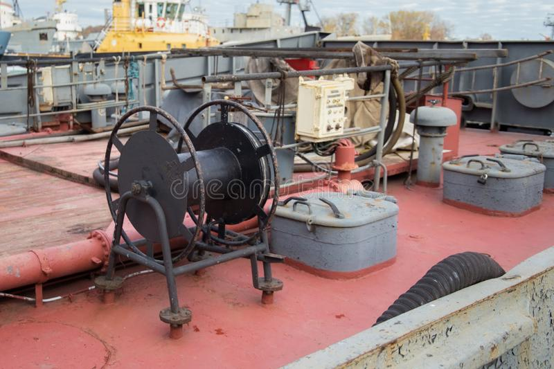 Black winch with on the ship deck. Black metal winch with on the ship deck stock image