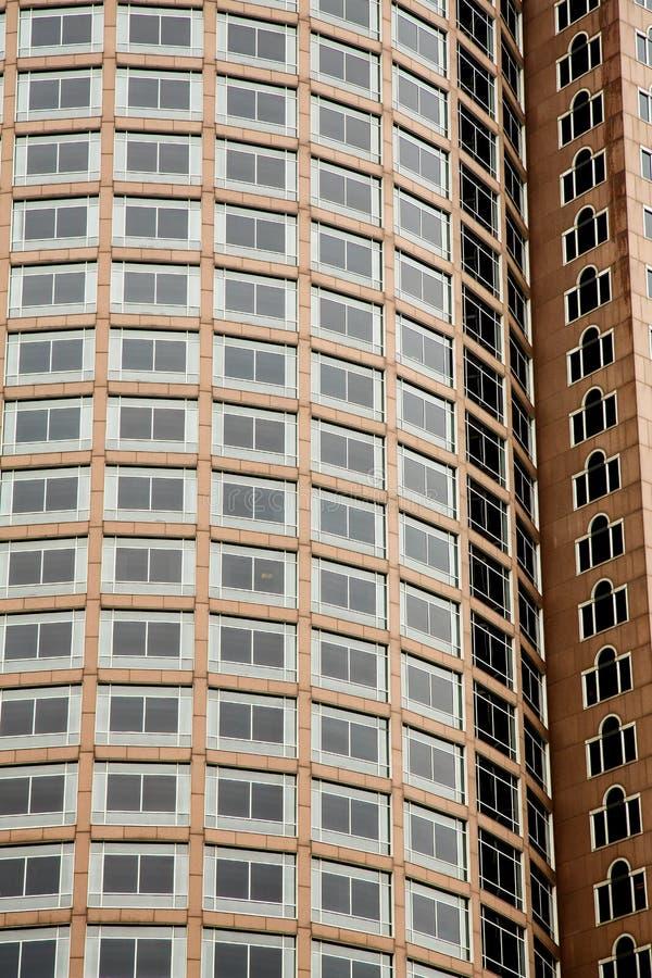 Black Windows on Round Brown Stone Building
