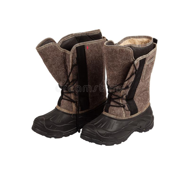 Black winter work boots isolated on white background royalty free stock photography