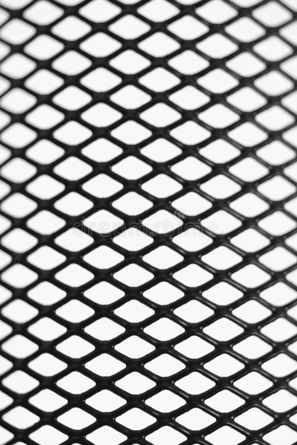 Black wire mesh pattern. On white background stock photo