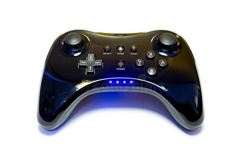 Black wireless game controller on white background with blue lights on royalty free stock image
