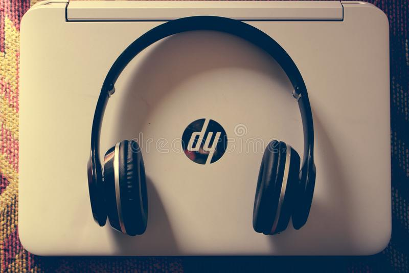Black Wireless Headphone Near White Hp Laptop stock images