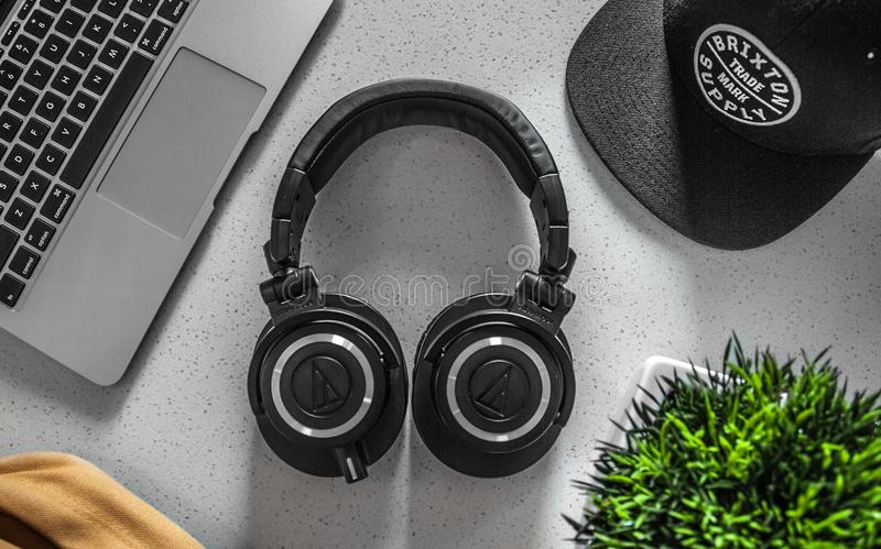Black Wireless Headphones On White Table stock image