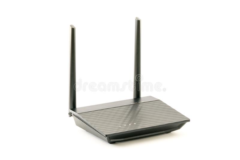 Black Wireless internet network wi-fi Router with two antenna isolated on white background. With clipping path. stock images