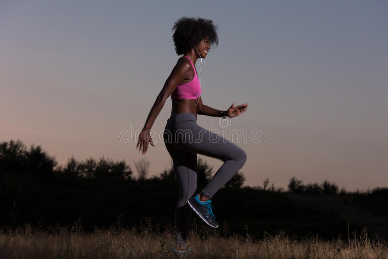 Black woman is doing stretching exercise relaxing and warm up royalty free stock images