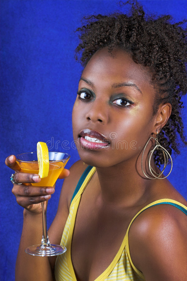Black woman drinking cocktail royalty free stock photos