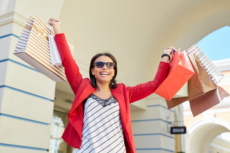 Black woman excited about shopping sales royalty free stock photos