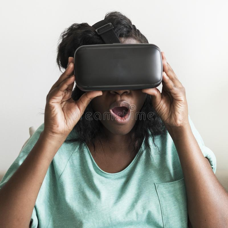 Black woman experiencing virtual reality with a VR headset royalty free stock images