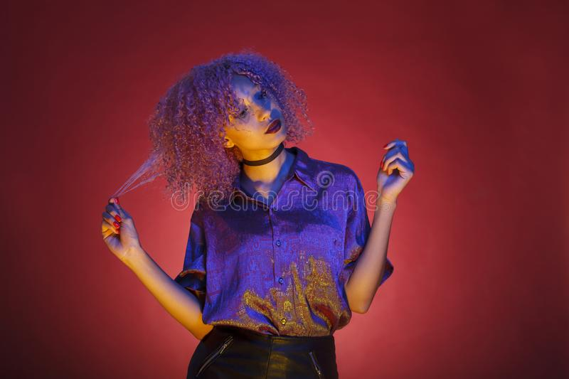 Black woman with groovy hair and nineteen style of electronic mu. Woman with groovy hair and nineteen style of electronic music stock photo