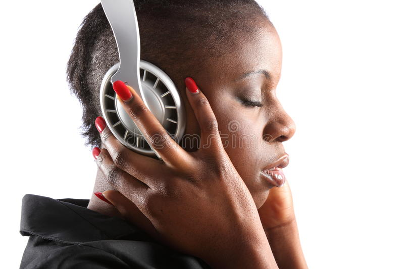 Black woman listening to music on headphones stock images