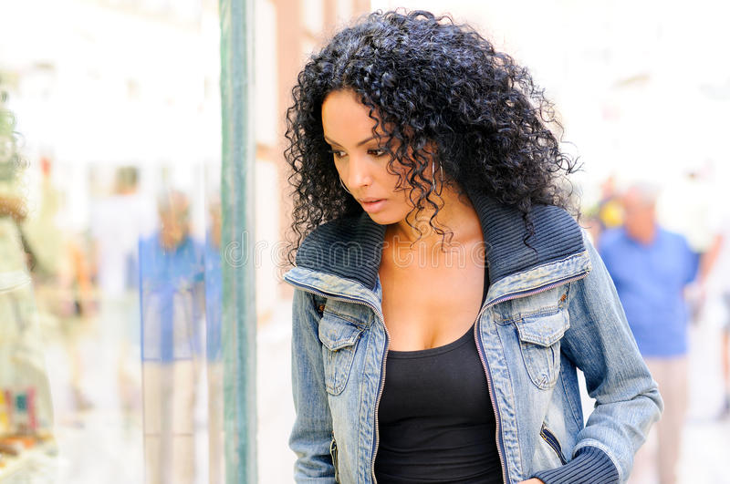 Download Black Woman Looking At The Shop Window Stock Photo - Image: 27125072