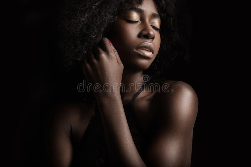 Black woman n a black background royalty free stock photo