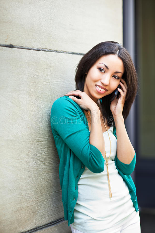 Black woman on the phone stock photography