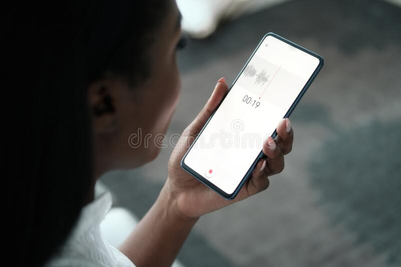 Black Woman Recording Voice Note On Mobile Phone stock photo