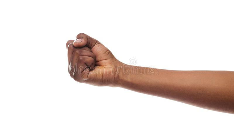 Black woman`s fist isolated on white background. Counting, aggression, brave concept. Black female fist, clenched hand, isolated on white background royalty free stock photo
