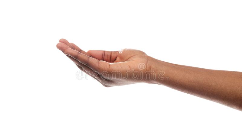 Black woman`s hand keeping empty cupped palm on white background. Offering or begging. Black woman`s hand keeping empty cupped palm isolated on white background stock images