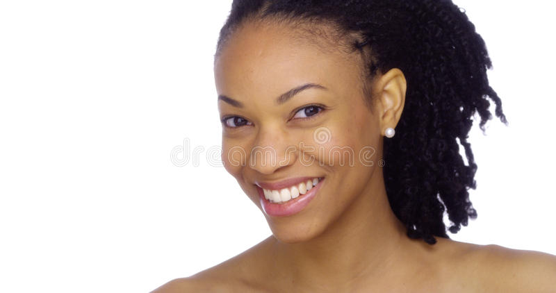Black woman showing off her pearly whites stock images