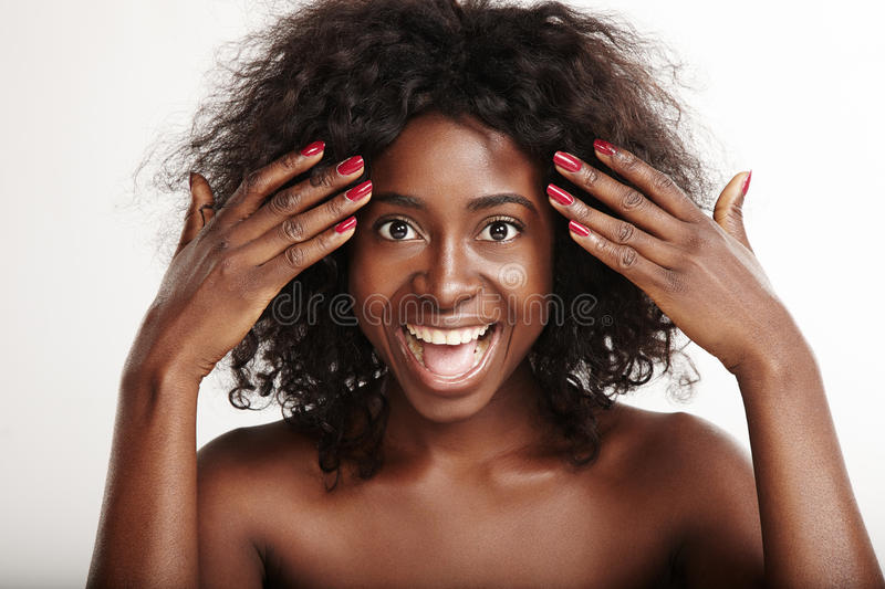 Black woman is surprised when open her eyes. Hands stock photography
