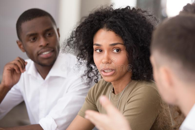Black woman team leader chatting with colleagues during formal meeting. Black confident businesswoman leader discuss planning future business growth strategy stock image