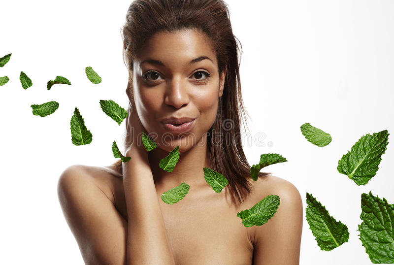 Black woman touching blow out freshness, leavs of mint royalty free stock photography