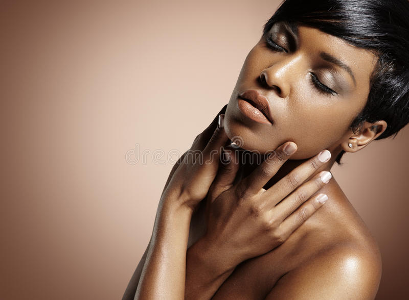 Black woman touching her face stock photo