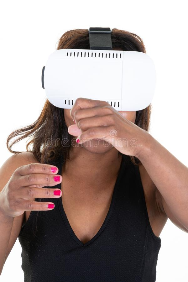 Black woman with virtual reality goggles in studio shot white background royalty free stock image