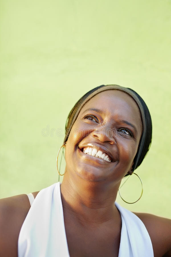 Download Black Woman With White Shirt Smiling Royalty Free Stock Photo - Image: 20189875