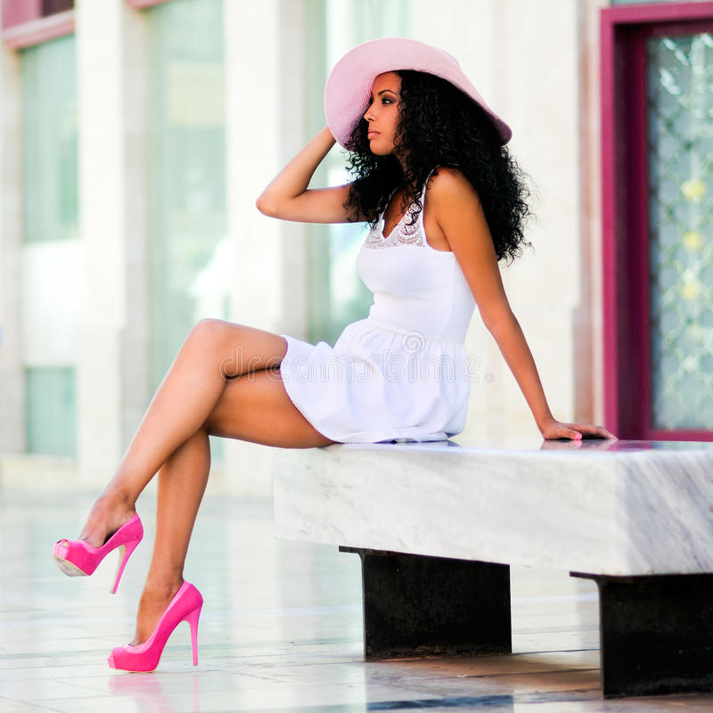 Download Black Woman Wih Dress And Sun Hat, Afro Hairstyle Stock Photo - Image of city, bench: 27399054