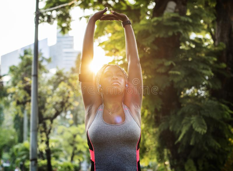Black woman working out early morning stock photography
