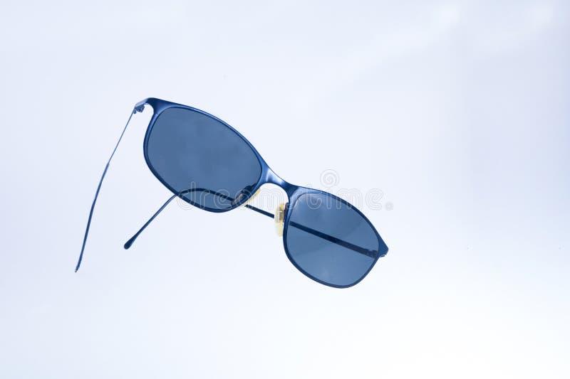 Black wommen sunglasses on isolated white background. WoMen sunglasses color black on isolated white background limbo royalty free stock image