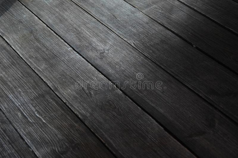 Black wood floor texture, hardwood. Floor texture royalty free stock images