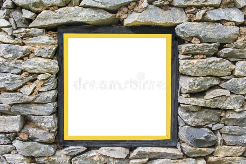 Black wood picture frame with gold border on old stone wall background stock photo