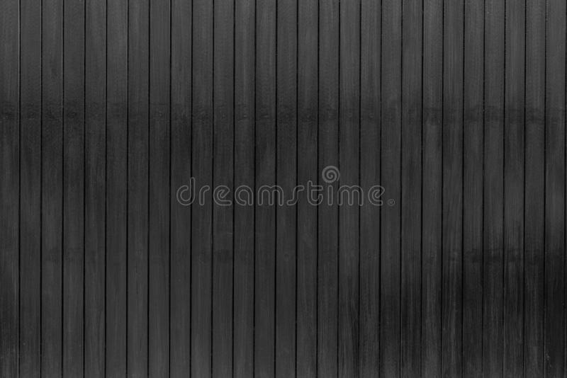 Black wood texture background. Dark wood plank abstract background. Empty black wooden wall. Wooden board. Black hardwood timber. stock photography