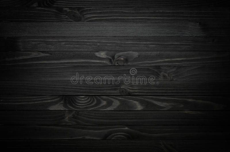Black Wood Texture. Dark black wood texture background viewed from above. The wooden planks are stacked horizontally royalty free stock photo