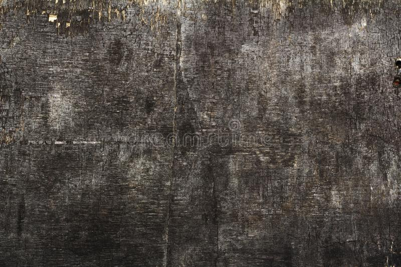 Black wooden background texture High quality. Can be used for design as a background or other. Copy space. Wooden black background.  royalty free stock images