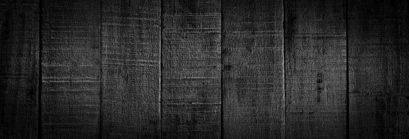 Black wooden boards background stock image