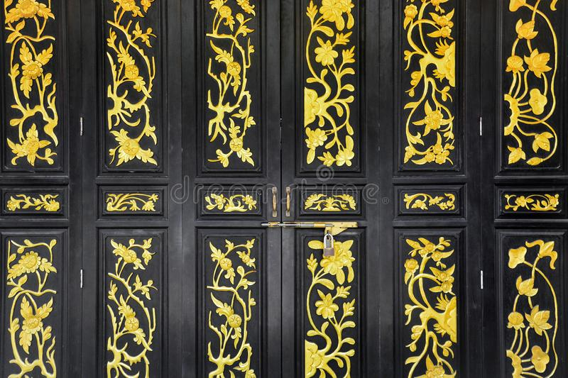 Black wooden chinese vintage style carved folding doors stock images