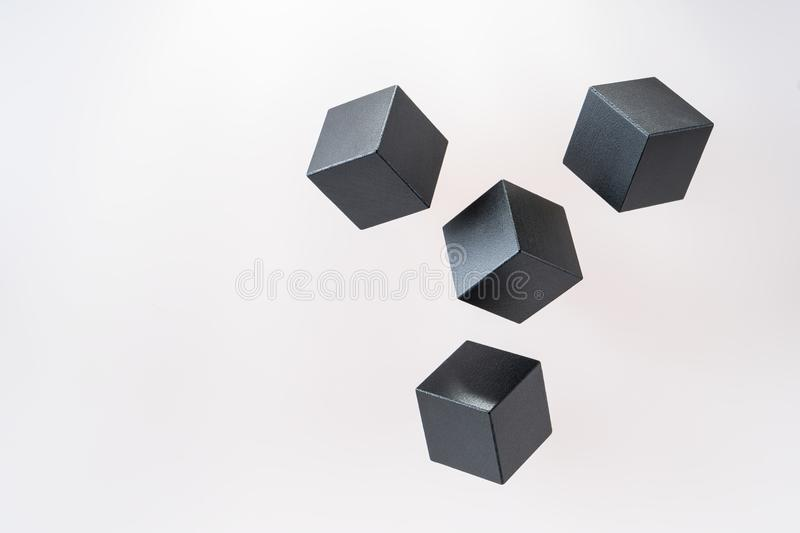 Black wooden cube shapes are floating. stock image