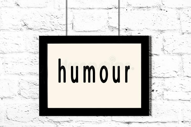 Black frame hanging on white brick wall with inscription humour. Black wooden frame with inscription humour hanging on white brick wall royalty free illustration