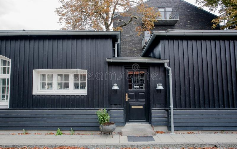 Black wooden house in tradition style of Copenhagen, Denmark. Historical city street. Black wooden house in tradition style of old Copenhagen, Denmark royalty free stock photos