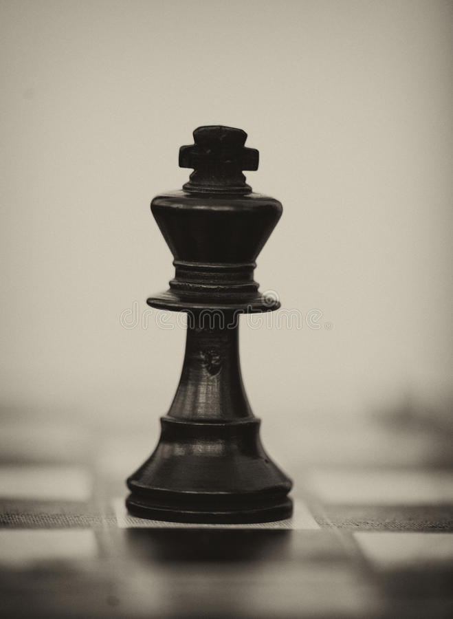 Black wooden king chess piece stock image