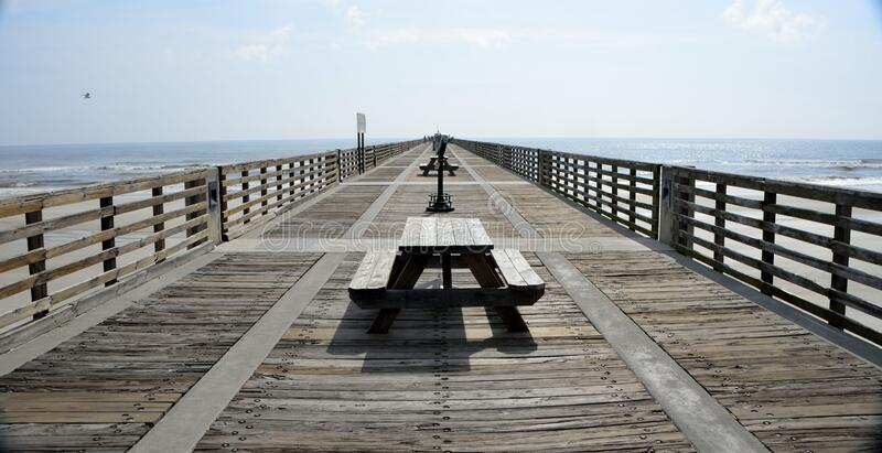 Black Wooden Picnic Table on the Wooden Dock royalty free stock images