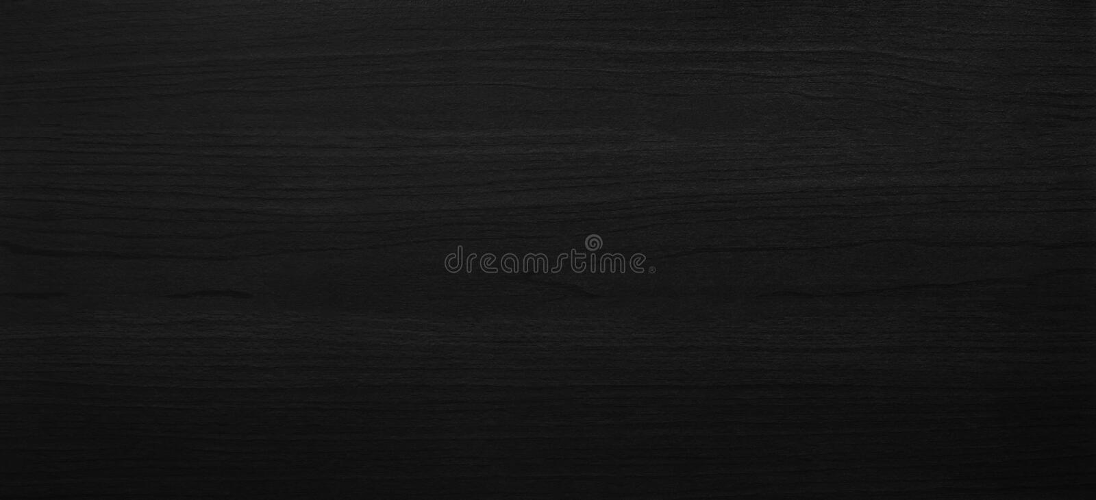Black wooden texture background with abstract pattern surface. Dark wood plank furniture made from hardwood material and desk or royalty free stock photo