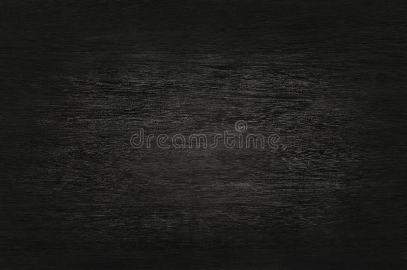 Black wooden wall background, texture of dark bark wood. stock image