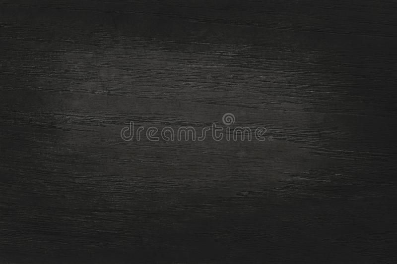 Black wooden wall background, texture of dark bark wood with old natural pattern for design art work, top view of grain timber.  stock image